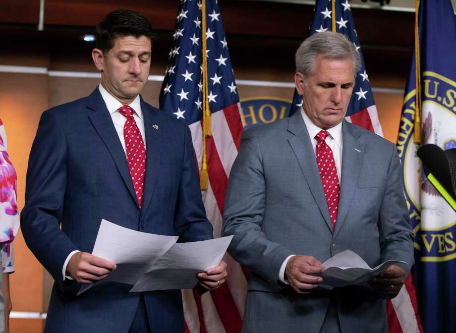 Speaker of the House Paul Ryan, R-Wis., left, and Majority Leader Kevin McCarthy, R-Calif., review papers before answering questions from reporters, on Capitol Hill in Washington, Tuesday, July 17, 2018. Responding to criticism about President Donald Trump and his Helsinki news conference with Russian President Vladimir Putin, Ryan said there should be no doubt that Russia interfered in the 2016 presidential election. Photo: J. Scott Applewhite, AP / Copyright 2018 The Associated Press. All rights reserved