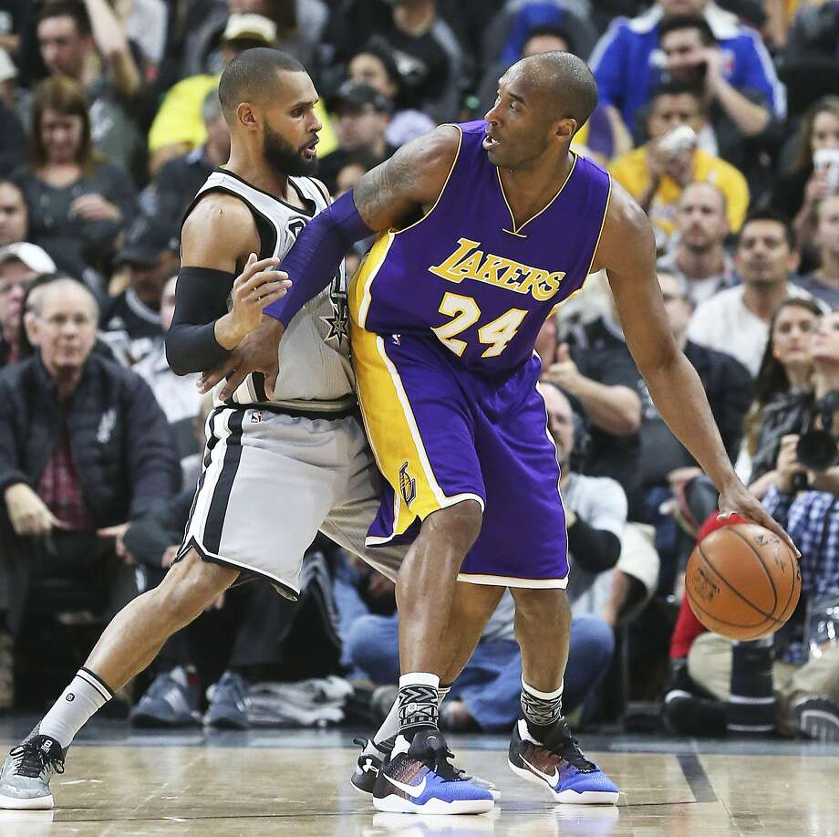 Kobe Bryant is fronted by Patty Mills as the Spurs host the Lakers at the AT&T Center on February 6, 2016. Photo: Tom Reel, SAN ANTONIO EXPRESS-NEWS