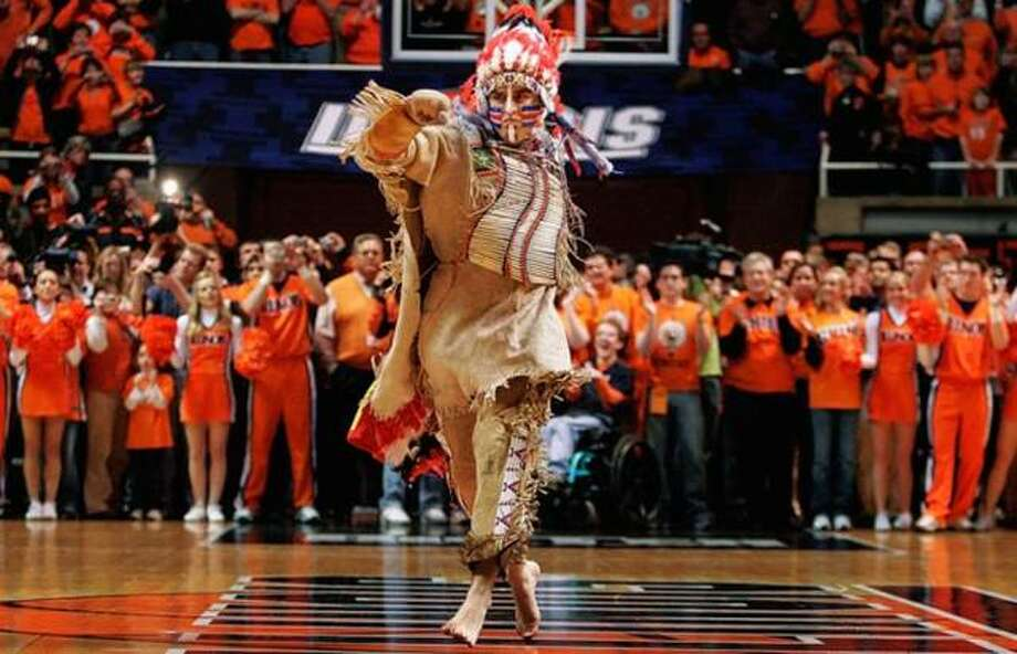 "In this Feb. 21, 2007 file photo, University of Illinois mascot Chief Illiniwek performs for the last time during an Illinois basketball game in Champaign, Ill. Illinois says the school is ending its tradition of playing ""war chant"" music during sporting events. Athletic department spokesman Kent Brown says the Illini made the decision in an effort to be more inclusive and because students haven't responded to it as much at football games. The music stems from the school's former mascot, Chief Illiniwek, a tradition that ended in 2007. (AP Photo/Seth Perlman, File)"