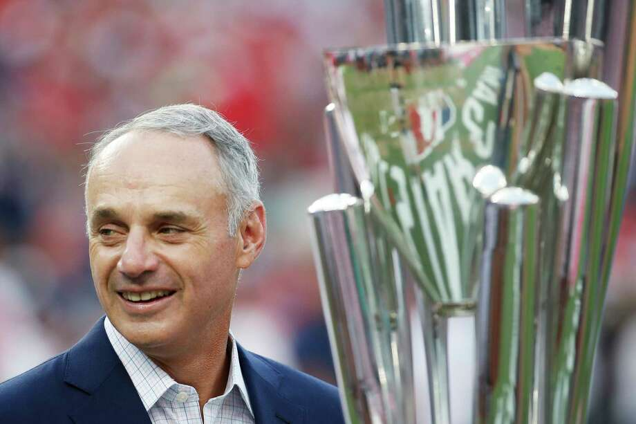 Major League Baseball Commissioner Rob Manfred stands with trophy before the MLB Home Run Derby, at Nationals Park, Monday, July 16, 2018 in Washington. The 89th MLB baseball All-Star Game will be played Tuesday. (AP Photo/Alex Brandon) Photo: Alex Brandon, Associated Press / © 2018 The Associated Press. All rights reserved