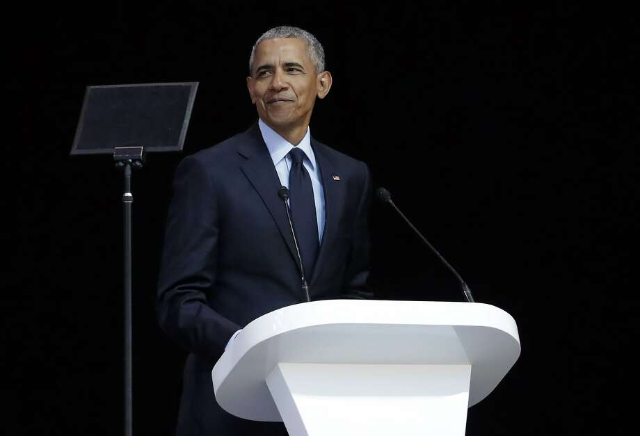 Ex-President Barack Obama speaks at the 16th Annual Nelson Mandela Lecture in Johannesburg. Photo: Themba Hadebe / Associated Press