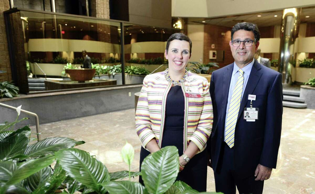 Liz Longmore and Dr. Rod Acosta, two of the executives of Stamford Health Medical Group, are photographed on July 12, 2018, in the lobby of 1 Omega Drive, in the River Bend office complex, in Stamford, Conn. Stamford Health Medical Group will be relocating its administrative offices in September to 1 Omega Drive.