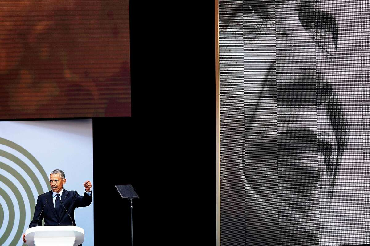 TOPSHOT - Former US President Barack Obama speaks during the 2018 Nelson Mandela Annual Lecture at the Wanderers cricket stadium in Johannesburg on July 17, 2018. - Former US president Barack Obama will deliver the Nelson Mandela Annual Lecture, urging young people to fight to defend democracy, human rights and peace, to a crowd of 15,000 people at the club as the centrepiece of celebrations marking 100 years since Nelson Mandela's birth. Obama has made relatively few public appearances since leaving the White House in 2017, but he has often credited Mandela for being one of the great inspirations in his life. (Photo by MARCO LONGARI / AFP) (Photo credit should read MARCO LONGARI/AFP/Getty Images) *** BESTPIX ***