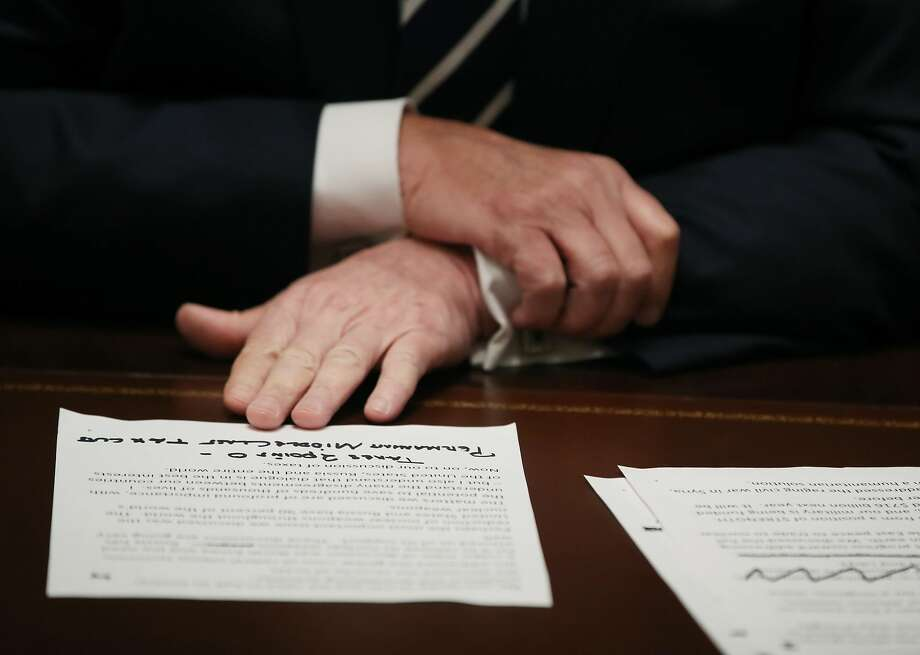 President Donald Trump holds his notes as he talks about his meeting with Russian President Vladimir Putin, during a meeting with House Republicans in the Cabinet Room of the White House on July 17, 2018 in Washington, DC. Following a diplomatic summit in Helsinki, Trump faced harsh criticism after a press conference with Putin where he would not say whether he believed Russia meddled with the 2016 presidential election. Photo: Mark Wilson/Getty Images