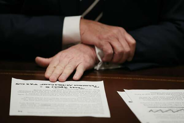 President Donald Trump holds his notes as he talks about his meeting with Russian President Vladimir Putin, during a meeting with House Republicans in the Cabinet Room of the White House on July 17, 2018 in Washington, DC. Following a diplomatic summit in Helsinki, Trump faced harsh criticism after a press conference with Putin where he would not say whether he believed Russia meddled with the 2016 presidential election.