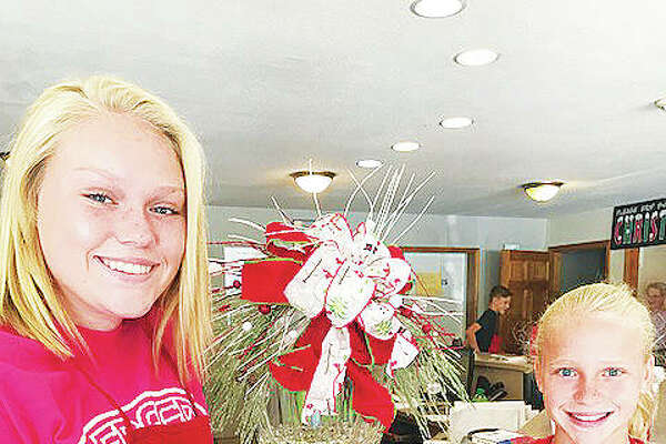 Community Christmas collecting started two months ago with the announcement of this year's date for the annual Christmas in July, taking place Friday at Freer Auto Body in Godfrey. Collection continues at the event, led by the daughters, Taylor and Lily Freer, of the shop's owner and President Tim Freer. Last year, the event raised $40,000-plus.