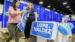 Miranda Herrera, left, and Tiffany Miller assemble campaign signs for Lupe Valdez, democratic candidate for governor, as they prepare for the Texas Democratic Convention on Thursday, June 21, 2018 at the Fort Worth Convention Center in Fort Worth. Miller and Herrera are both campaign staff for Valdez. (Ashley Landis/The Dallas Morning News)