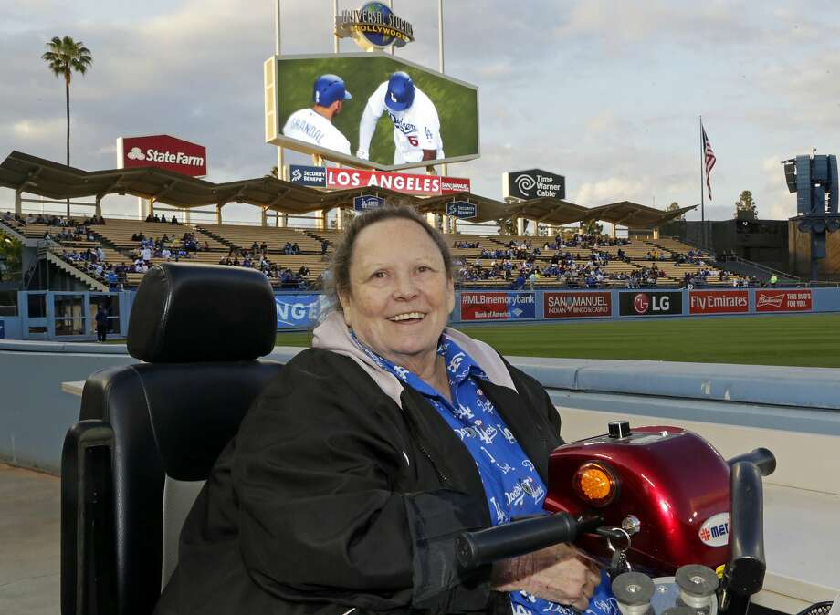 Retired Associated Press reporter and editor Sue Manning takes her field seat at Dodger Stadium in Los Angeles. Photo: Reed Saxon / Associated Press 2016