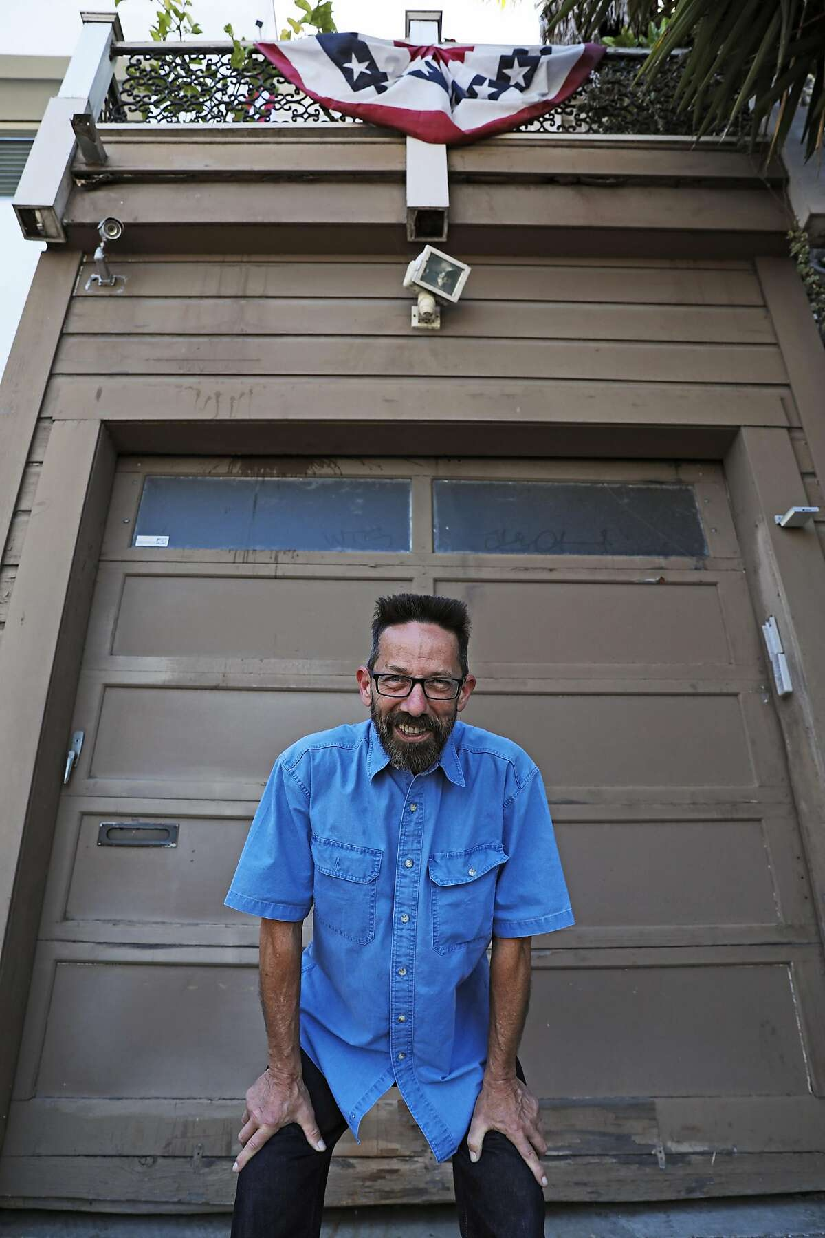 Jo Babcock stands in front of 1002 Pennsylvania Ave. on Thursday, July 12, 2018, in San Francisco, Cali. Babcock, a photographer, took an iconic image of the house, an old Victorian, right next to a huge gas storage tank. The tank is gone, but the house remains.
