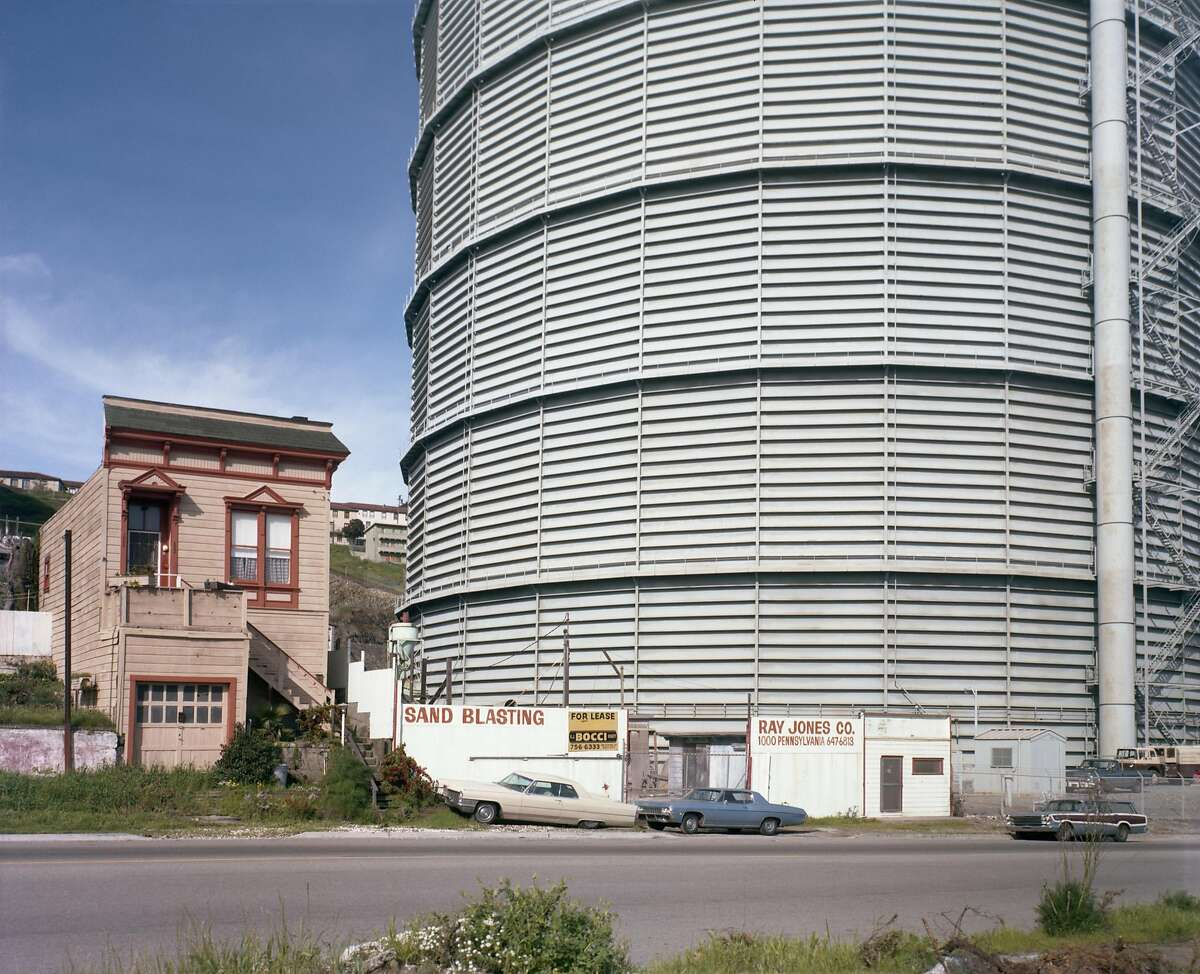 Photo 1: This 1980s photo shows San Francisco's Dogpatch neighborhood as the bleak neighborhood it was in those days.Photo 2: A gray, steel gas storage tank next to a run-down Victorian on Pennsylvania Avenue near 25th Street in San Francisco's Dogpatch neighborhood about 1980.Photo 3: A view of Minnesota Street in San Francisco's Dogpatch neighborhood in the 1980s.