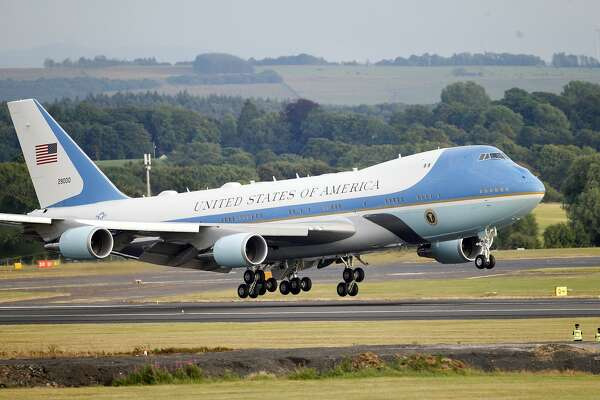 Air Force One with U.S. President Donald Trump and first lady Melania Trump lands at Prestwick Airport, Scotland, Friday, July 13, 2018. Trump is due to play golf at his nearby Turnery course on Saturday. (AP Photo/Peter Morrison)