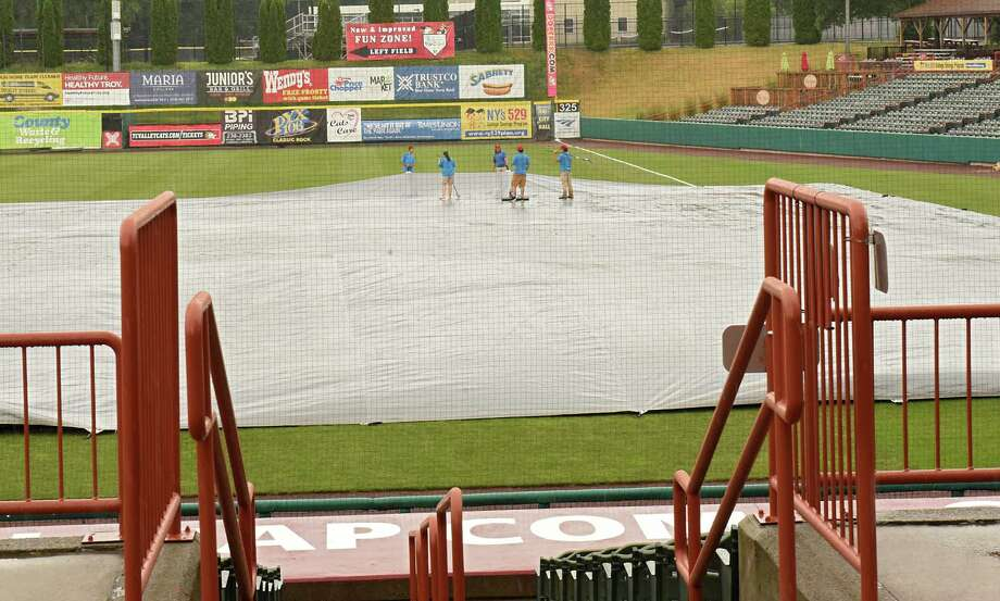 The ground crew works on keeping the infield dry a few hours before a Tri-City ValleyCats baseball game against the Brooklyn Cyclones at the Joe Bruno Stadium on Tuesday, July 17, 2018 in Troy, N.Y. (Lori Van Buren/Times Union) Photo: Lori Van Buren, Albany Times Union