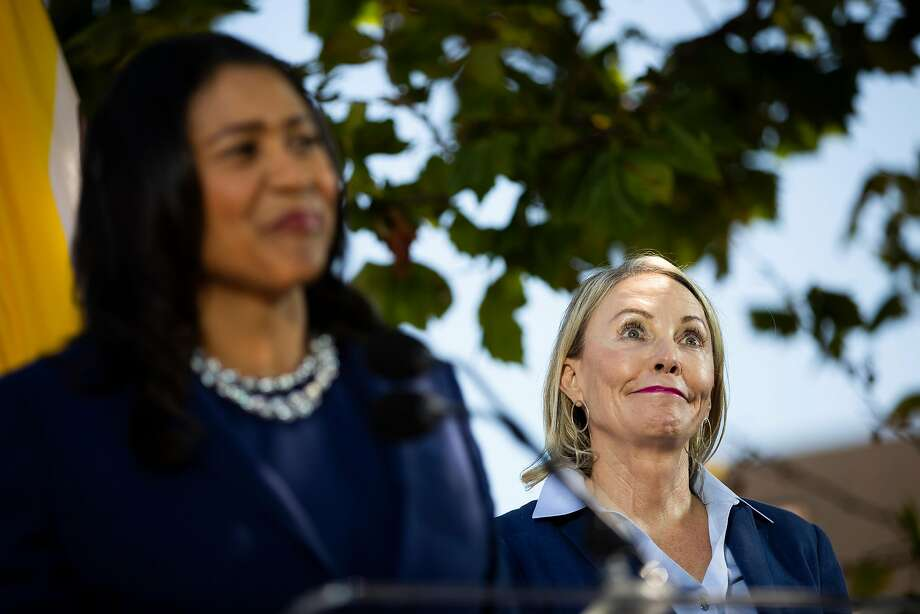 Newly appointed District 5 Supervisor Vallie Brown, right, is introduced by San Francisco Mayor London Breed during Brown's swearing-in ceremony at the Hayes Valley Playground on Monday. Photo: Stephen Lam / Special To The Chronicle