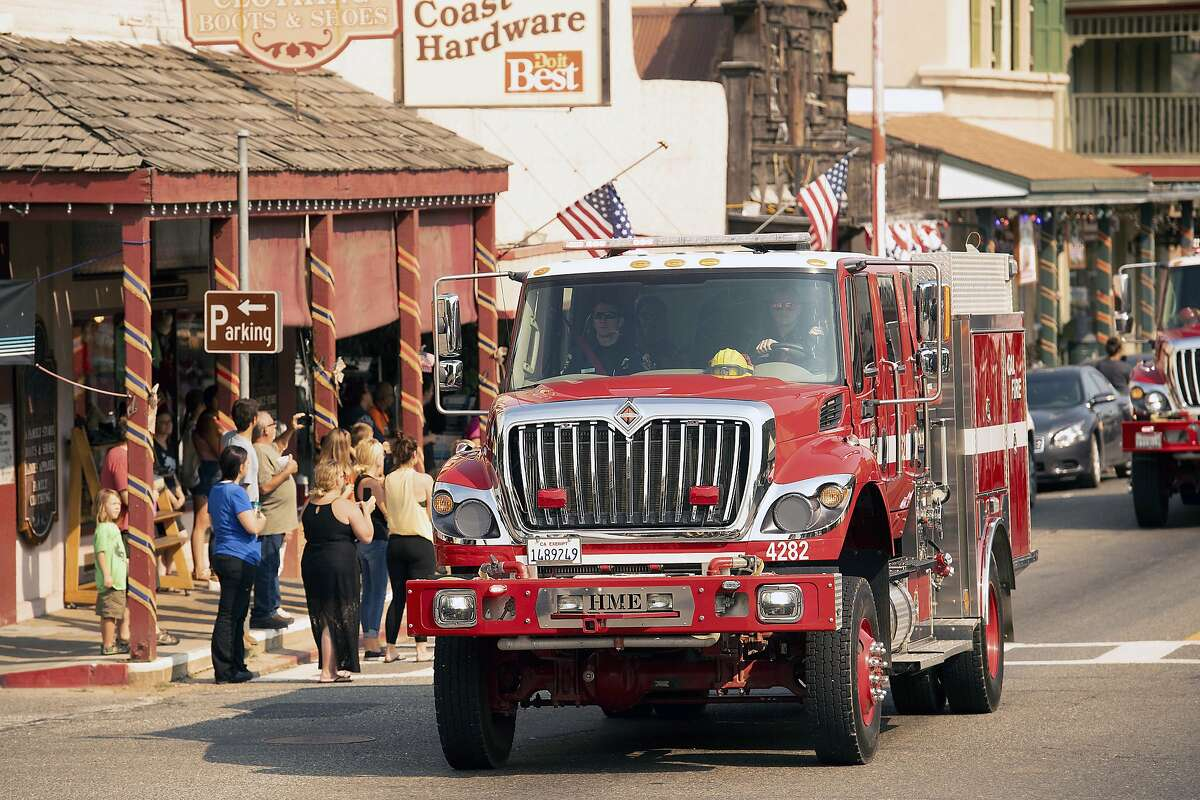 A fire truck, part of a procession carrying the body of firefighter Braden Varney, makes its way along Highway 140 on Monday, July 16, 2018, in Mariposa, Calif. Varney died when his bulldozer overturned as he battled the Ferguson fire. (AP Photo/Noah Berger)