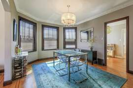 The dining room at 2373 14th Ave. in San Francisco's West Portal neighborhood features bay windows, an inlaid hardwood floor and intricate moldings.