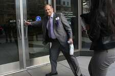 Assembly member Bill Quirk (D-Hayward) re-enters the building where Bart management and union leaders are at the bargaining table this morning in Oakland, California, on Friday, October 11, 2013.  He took a break for lunch to get a Subway sandwich.
