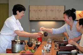 Anabel Lee, right, gives some cookies to Junko Schwesig during Oyatsuya, is a Sunday-afternoon pop-up by Schwesig, hosted at a sushi bar in San Francisco , Calif., on Sunday, July 15, 2018. Schwesig serves a multi-course tasting menu of Japanese sweets along with super-premium Japanese teas, including gorgeous little bites that are all about the peak of the season.