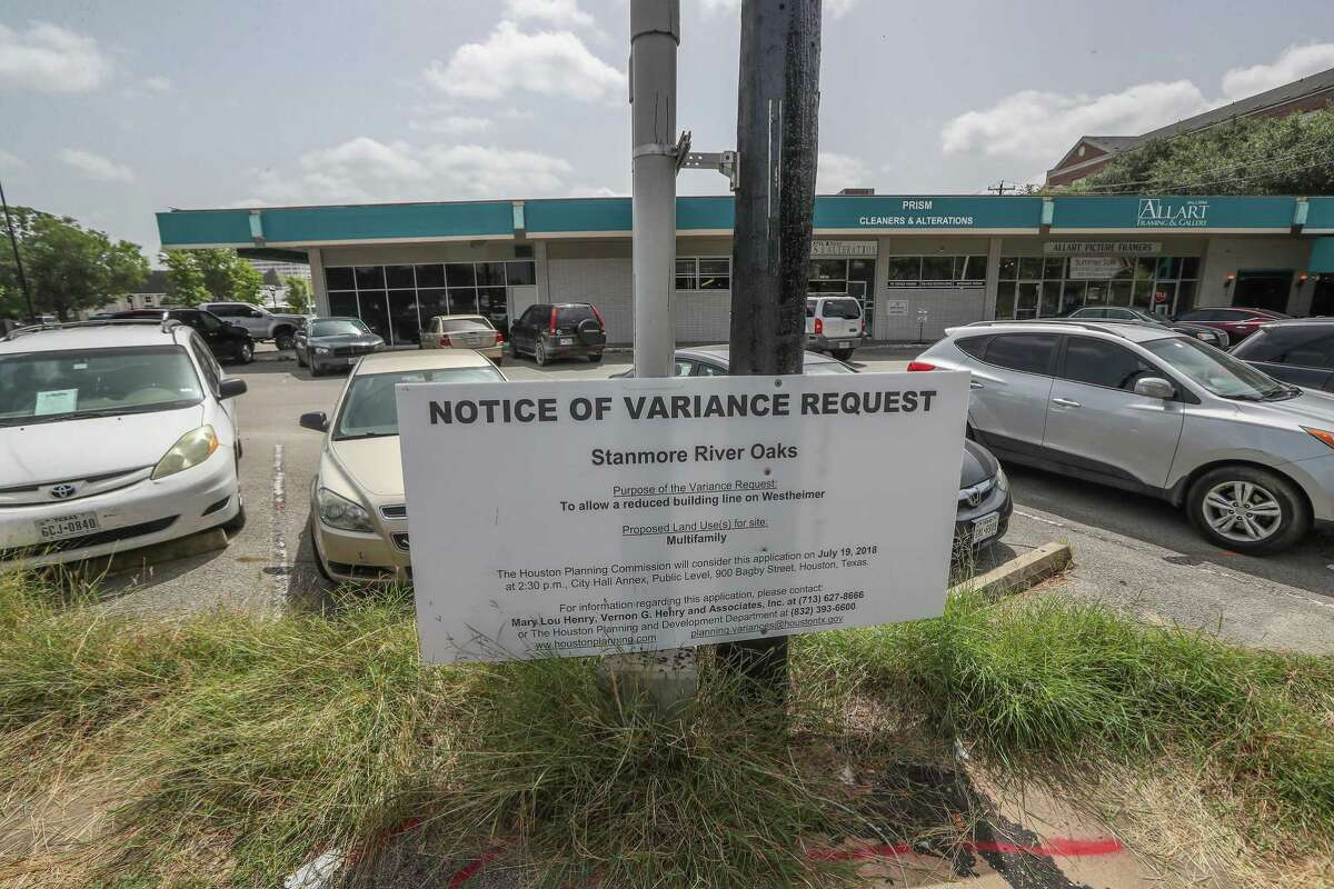 Signs point to a developer planning to build an 8-story apartment complex in the 2300 block of Westheimer.Tuesday, July 17, 2018, in Houston. The apartments would replace the existing shopping center, which houses an antique mall, dry cleaners, framer and the original Berryhill restaurant. ( Steve Gonzales / Houston Chronicle )