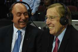LAS VEGAS, NV - MARCH 07:  Sportscasters Dick Vitale (L) and Brent Musburger broadcast before a semifinal game of the West Coast Conference Basketball tournament between the Pepperdine Waves and the Saint Mary's Gaels at the Orleans Arena on March 7, 2016 in Las Vegas, Nevada.  (Photo by Ethan Miller/Getty Images)