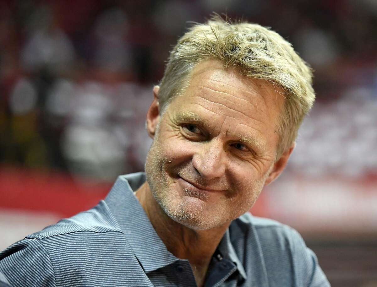 Head coach Steve Kerr of the Golden State Warriors smiles before the team's 2018 NBA Summer League game against the Dallas Mavericks at the Thomas & Mack Center on July 9, 2018 in Las Vegas, Nevada.