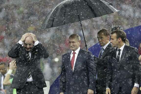 The World Cup allowed Russian President Vladimir Putin, center, shown her with French President Emmanuel Macron after the final match, to burnish Russia's image abroad. It's debatable how much good it did him at home.