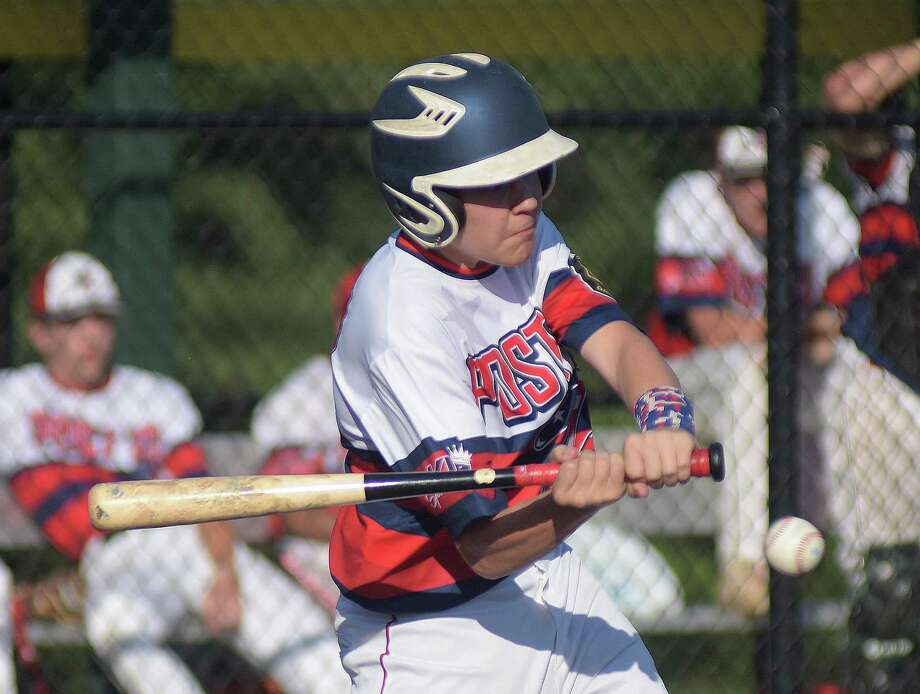 A Norwalk batter swings during a game against Wilton Post 86 on July 10. Norwalk had to forfeit its games after using ineligible players. General manager Joe Parlanti refused to identify which players had been ineligible. Photo: John Nash / Hearst Connecticut Media