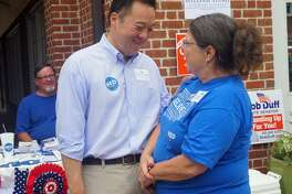 State Rep. William Tong (left), a Stamford Democrat who is running for attorney general, laughed with Christine Castles (right), treasurer of the Darien Democratic Town Committee, at the Darien Sidewalk Sale on Saturday July 14, 2018.