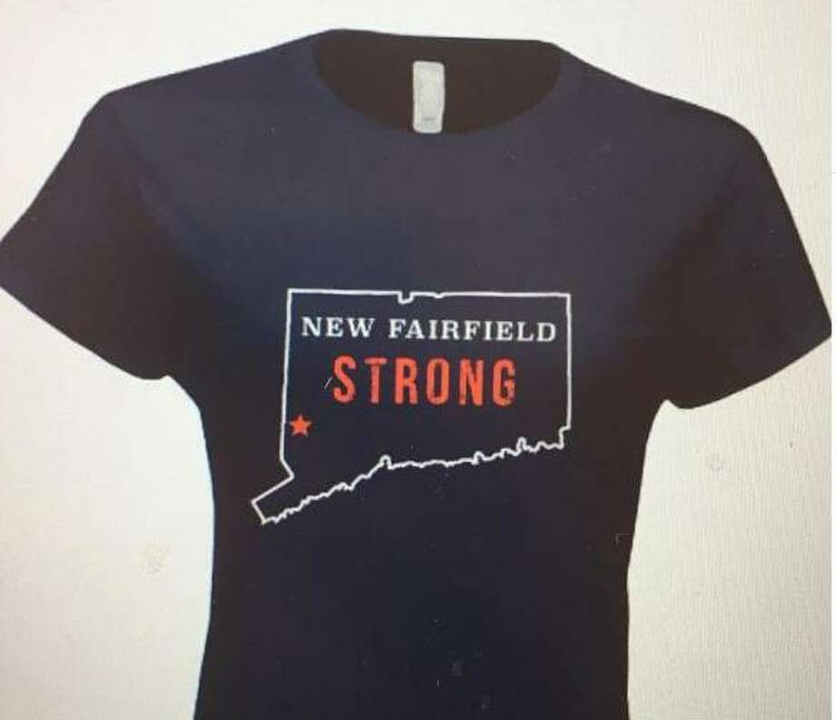 "The New Fairfield Community Service Club will sell ""New Fairfield Strong"" T-shirts to raise money for a storm recovery fund that will be administered by the town's Social Services department to residents who may need help repairing severe damage from May's storm. Photo: Contributed Photo / Hearst Connecticut Media / The News-Times Contributed"