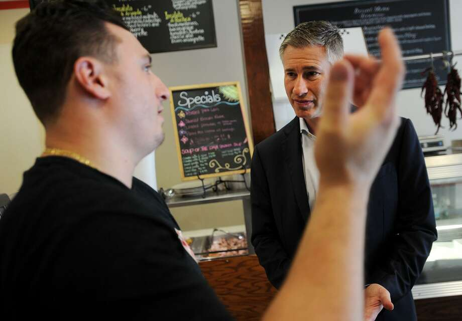 Republican candidate for governor David Stemerman, right, talks with DiGiovanni's Cafe & Catering owner Nicholas DiGiovanni while on the campaign trail in Ansonia, Conn. on Tuesday, July 16, 2018. Photo: Brian A. Pounds / Hearst Connecticut Media / Connecticut Post