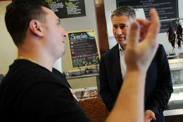 Republican candidate for governor David Stemerman, right, talks with DiGiovanni's Cafe & Catering owner Nicholas DiGiovanni while on the campaign trail in Ansonia, Conn. on Tuesday, July 16, 2018.