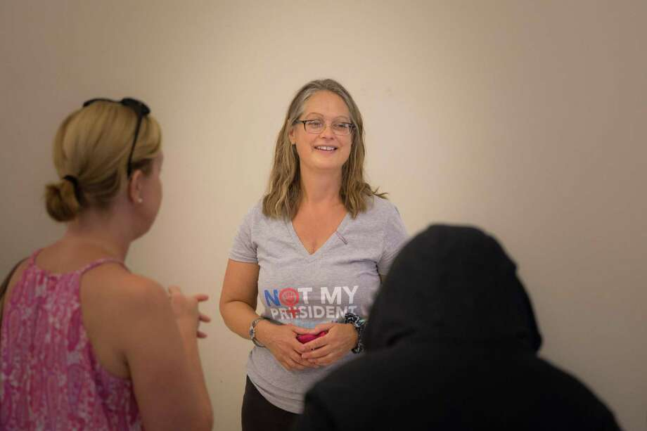 One of the event coordinators, Irene Meltzer, talks with rally goers before the rally to oppose the separation of immigrant children and their families. It was sponsored by the Acton Together Network. The event started at 4pm at St. John's Episcopal Church in New Milford, CT. Photo: Trish Haldin / The News-Times Freelance