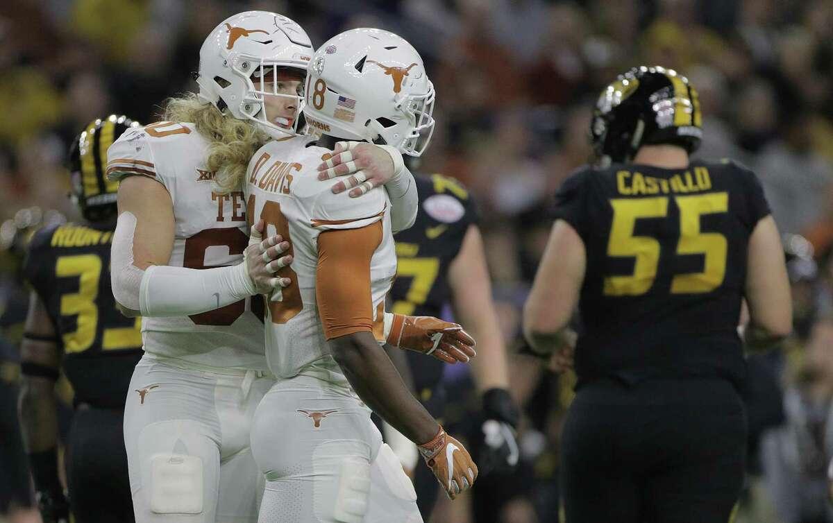 Texas linebacker Breckyn Hager, hugging teammate Davante Davis, became a team leader in 2017.