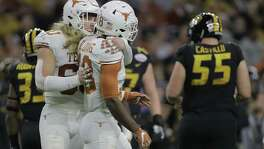 Texas linebacker Breckyn Hager, hugging teammate Davante Davis, became a team leader in 2017.