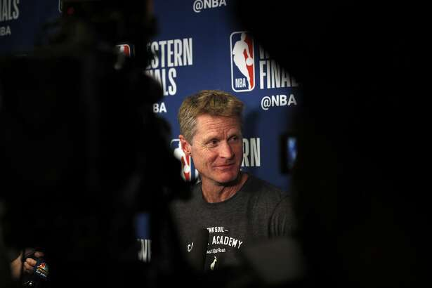 Warriors head coach Steve Kerr speaks to the media following a team meeting in preparation for Game 7 of the Western Conference Finals at the Four Seasons Hotel after the team arrived in Houston, Texas, on Sunday, May 27, 2018.