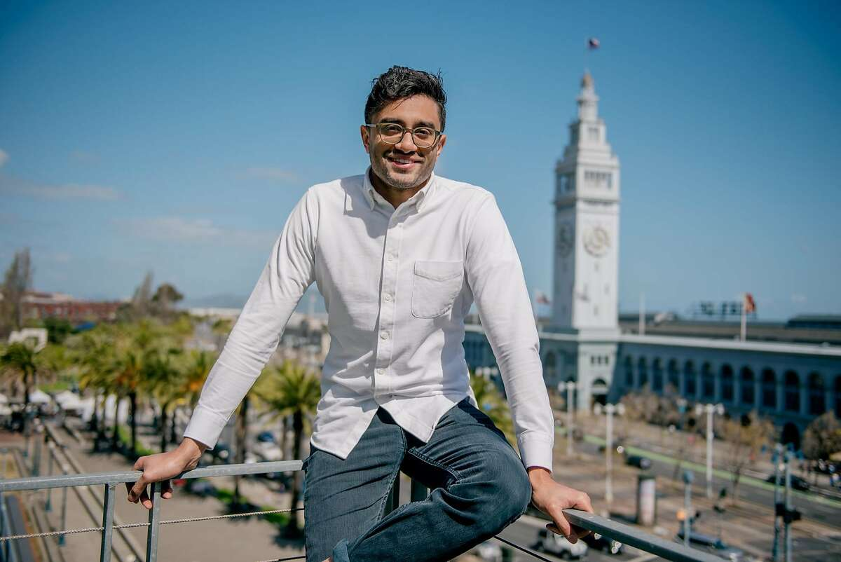 Aneesh Chaganty sits for a portrait on a rooftop overlooking the Ferry Building, on April 8, 2018.