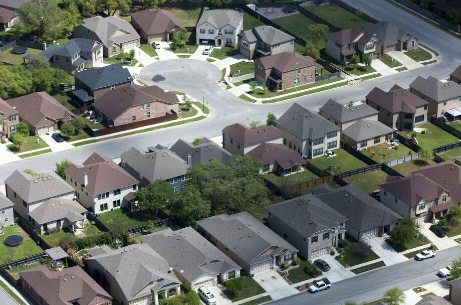 "Title insurance company Amrock Inc. said it received information that a Bexar County jury trial that resulted in a $706 million verdict against the company was ""fraudulent."" It wants the verdict set aside. Real estate data analytics firm HouseCanary Inc. prevailed in the case. Pictured is a subdivision in Kendall County. Photo: William Luther /San Antonio Express-News / © 2017 San Antonio Express-News"