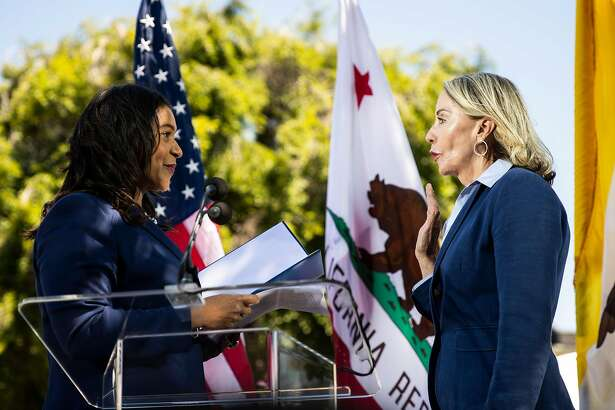 San Francisco Mayor London Breed, left, administers the oath of office to former legislative aide Vallie Brown as the new District 5 supervisor during a swearing-in ceremony at the Hayes Valley Playground in San Francisco, Calif. on Monday, July 16, 2018.