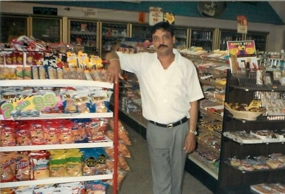 "Hasmukh ""Hash"" Patel stands inside his convenience store in 1988. He was murdered there in 2004. Photo: Courtesy Photo"