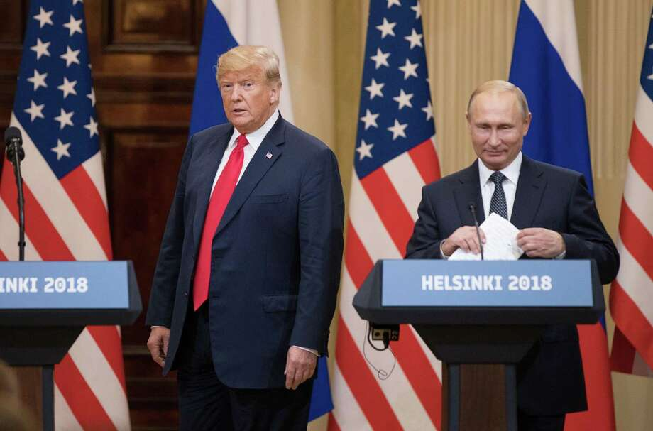 """U.S. President Donald Trump, left, and Vladimir Putin, Russia's president, center, arrive for a news conference in Helsinki, Finland, on Monday, July 16, 2018. Trumpcalled Special CounselRobert Mueller's probe into Russian election meddling a """"disaster"""" on Monday, again questioned whether Russia interfered in the 2016 election that he won and suggested he equally trusted his national intelligence director andPutin-- all as he stood next to the Russian leader. Photographer: Chris Ratcliffe/Bloomberg Photo: Chris Ratcliffe / Bloomberg / © 2018 Bloomberg Finance LP"""