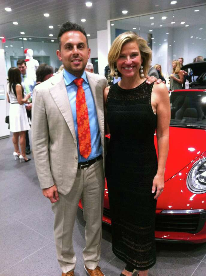 Porsche vice president Jacob Harb, left, and Connecticut Open tennis tournament director Anne Worcester gather at a ceremony celebrating the partnership between Porsche and the tournament held Tuesday, July 17, 2018 in Greenwich. Porsche is one of the sponsors of the Connecticut Open and is the official car of the event. Photo: David Fierro / Hearst Connecticut Media / David Fierro / Hearst Connecticut Media / Greenwich Time Contributed