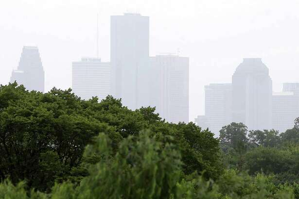 The hazy skyline of downtown is shown from I-45 near 610 on Sunday, July 15, in Houston. The dust travels from the Sahara Desert in Africa and will contribute to low air quality over the next few days. ( Melissa Phillip / Houston Chronicle )