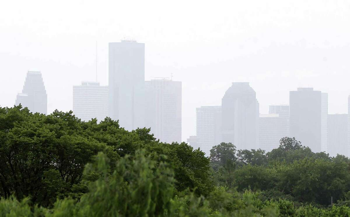 The hazy skyline of downtown is shown from I-45 near 610 Sunday, July 15, 2018, in Houston. Houston made the top 10 list for most polluted cities in the country for ozone, according to the 2019 American Lung Association