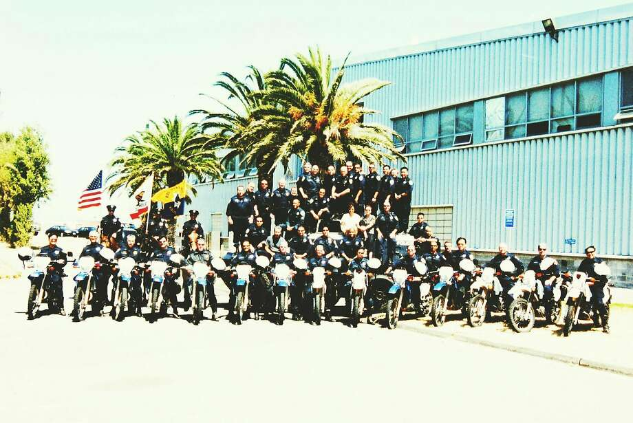 Members of the San Francisco Police Department's Special Operations Tactical Company take a group photo outside Building 606 at the former Hunters Point Naval Shipyard. Some officers who worked in the building worry that hazards in the shipyard may have compromised their health. Photo: San Francisco Police Department