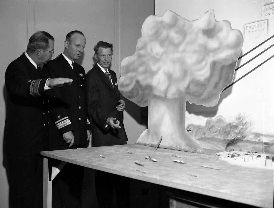 Rear Adm. Frederick Furth (left), Rear Adm. Albert Mumma and Dr. P.C. Tompkins at the Navy Radiological Defense Laboratory at the Hunters Point Naval Shipyard in San Francisco on Oct. 25, 1955. Photo: Bob Campbell / The Chronicle 1955