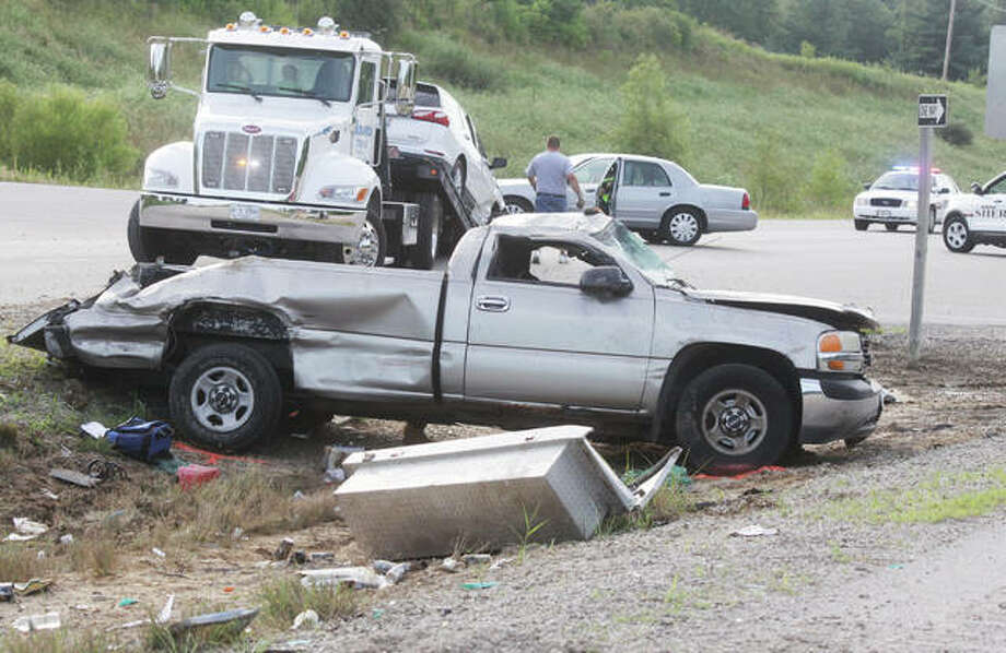 Workers clear the site of a serious two-vehicle accident on U.S. 67 just southeast of Lageman Road in Godfrey Tuesday evening. According to first responders on the scene, a grey/silver GMC pickup truck struck another vehicle and rolled over several times, before the driver was ejected. The driver of the pickup, identified only as a white male, was airlifted to a St. Louis hospital. There was no immediate information about his condition. The driver of the other vehicle declined treatment at the scene. Godfrey Fire Protection District and Madison County Sheriff's Department responded to the scene. As of Tuesday evening, the accident was still under investigation. Photo:       Scott Cousins | The Telegraph