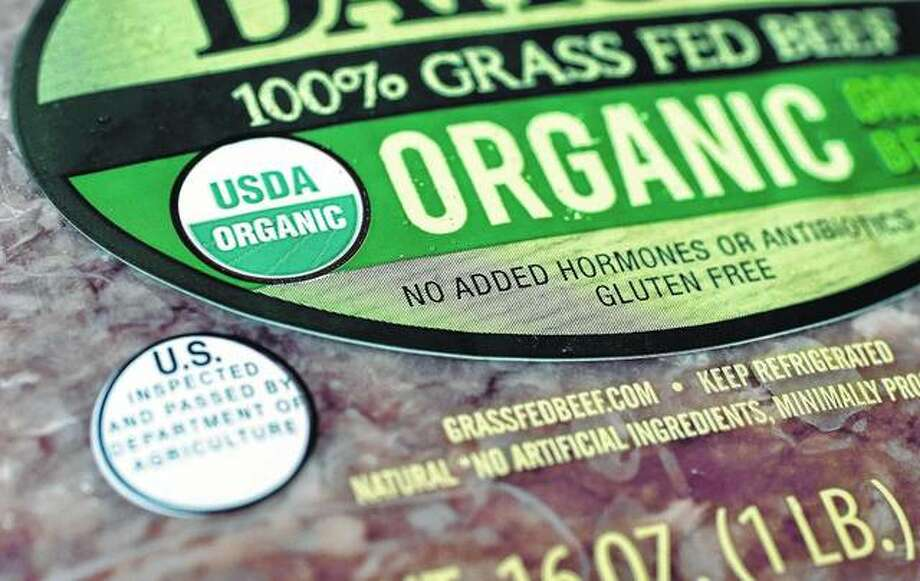 The USDA Organic label generally signifies a product is made without synthetic pesticides and fertilizers, and that animals are raised according to certain standards. But disputes over the rules and reports of fraud may have some questioning whether the seal is worth the price. Photo:       Steven Senne | AP