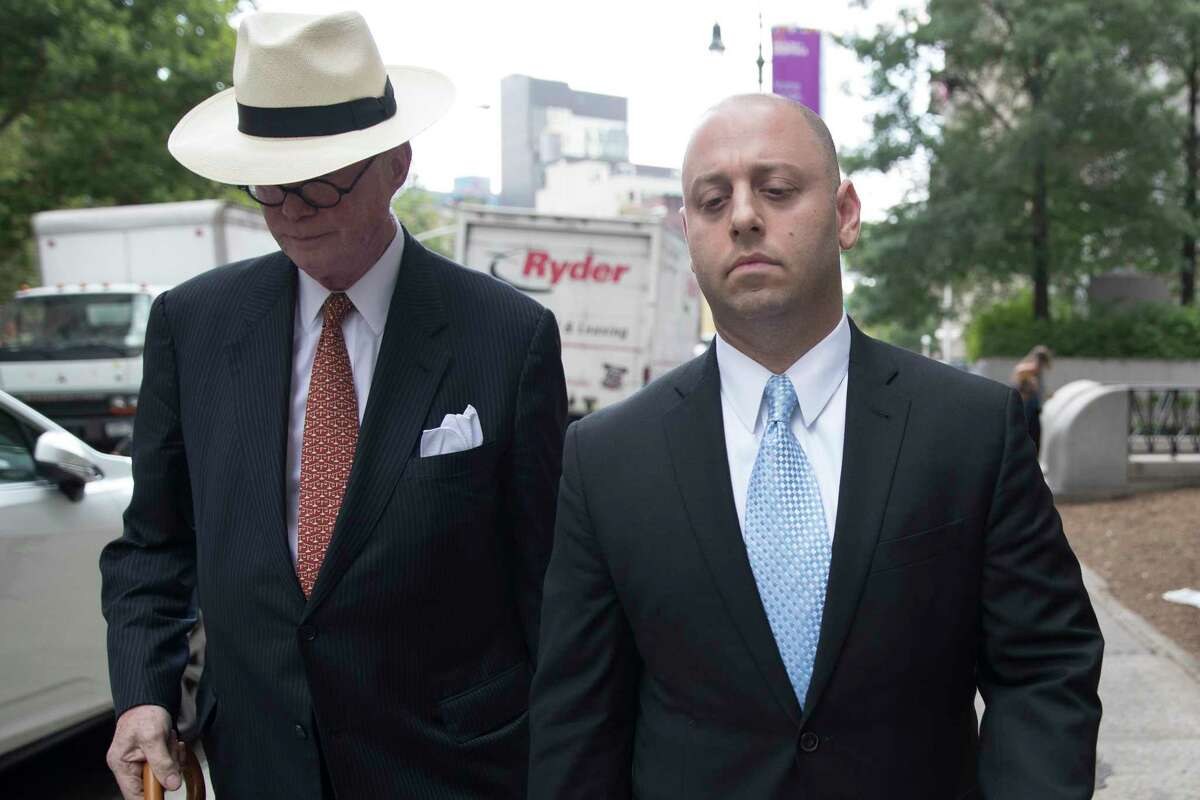 Adam Skelos, right, leaves federal court, Tuesday, July 17, 2018, in New York. Dean Skelos, the former New York state Senate leader, and his son Adam were convicted of extortion, wire fraud and bribery charges of pressuring businesses to give the son no-show jobs or else risk losing the powerful Republican's political support. (AP Photo/Mary Altaffer)