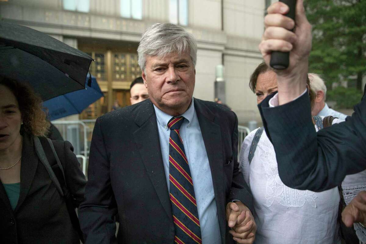 Dean Skelos, center, leaves federal court, Tuesday, July 17, 2018, in New York. The former New York state Senate leader and his son Adam were convicted on Tuesday of extortion, wire fraud and bribery charges of pressuring businesses to give the son no-show jobs or else risk losing the powerful Republican's political support. A judge agreed to allow Skelos to finish his sentence at home because of the coronavirus. (AP Photo/Mary Altaffer)