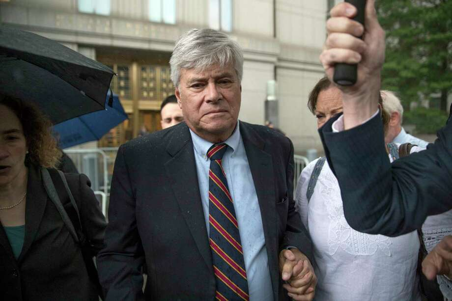 Dean Skelos, center, leaves federal court, Tuesday, July 17, 2018, in New York. The former New York state Senate leader and his son Adam were convicted of extortion, wire fraud and bribery charges of pressuring businesses to give the son no-show jobs or else risk losing the powerful Republican's political support. (AP Photo/Mary Altaffer) Photo: Mary Altaffer / Copyright 2018 The Associated Press. All rights reserved.