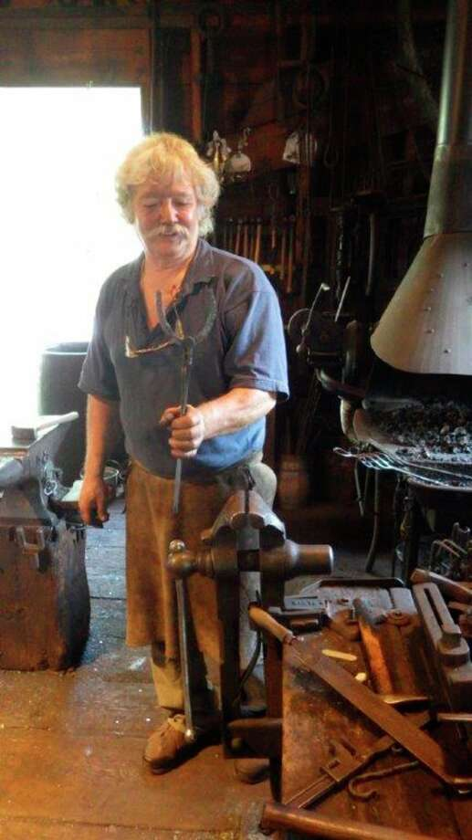 Pat Hayes is the blacksmith at the Benjamin Blacksmith Shop, which is part of the Mackinac Island State Park. (Hearst Michigan)